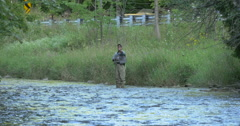View of a man fishing in the river at Caledon, Canada Stock Footage