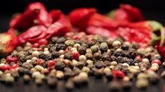 Pile of multi color peppercorns and dried chili, rotating Stock Footage