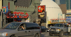 Cars driving by Dracula's Haunted Castle and Gags n'Giggles at Niagara Falls Stock Footage