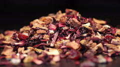 Pile of fruit tea with petals and dry fruit isolated on black, rotating Stock Footage
