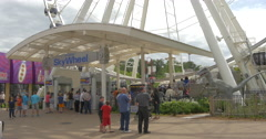 People talking and buying tickets for Niagara Skywheel Niagara Falls, Canada Stock Footage