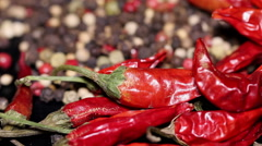 Pile of dried chili and peppercorns in the background, rotating Stock Footage