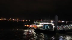 The Mersey Ferry pulling into the Pier Head landing stage at night Stock Footage