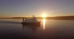 Aerial view ferry in sunrise with lighthouse Stock Footage