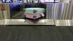 Luggage on conveyor belt in airport Stock Footage