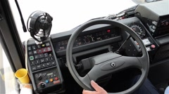 Bus driver drive the car holding the steering wheel and pressing buttons 1 Stock Footage
