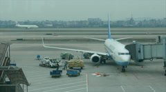 Airplane parking on apron, ground servicing Stock Footage