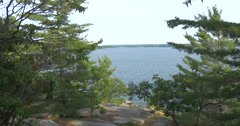 Beautiful view of the lake, rocks and trees at Killbear Provincial Park Stock Footage