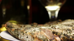 Baked salmon fish with aromatic herbs crust and wine, rotating Stock Footage