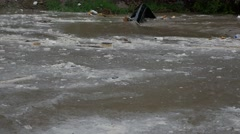 Trash flowing from Tijuana, Mexico after heavy rains 1 - stock footage