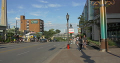People walking and cars driving on Murray Street at Niagara Falls, Canada Stock Footage