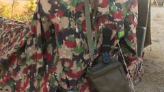 Military camouflage with radio station, bag and flask Stock Footage