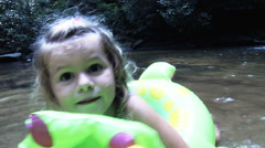 Children Playing In Creek On A Summer Day - stock footage