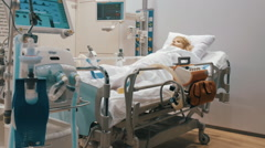 Mannequin is in intensive care, surrounded by a variety of medical equipment and Stock Footage