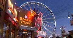 View of Boston Pizza, Niagara Skywheel and Rock N'Bowl at Niagara Falls, Canada Stock Footage