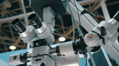 Surgical microscope with two pairs of eyepieces for microsurgery Stock Footage