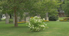 View of stone arches and pillars surrounded by trees at Kitchener, Canada Stock Footage