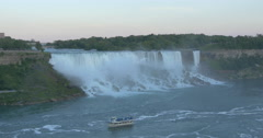 View of a boat navigating nearby the waterfall at Niagara Falls, Canada - stock footage