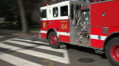 Fire engine responding, turns corner, siren, horn, DC Stock Footage