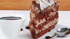 Stock Video Footage of breakfast hot coffee mug and cream chocolate layer cake