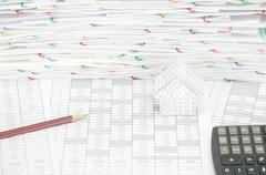 Brown pencil and house have pile of document as background Stock Photos