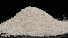 Pile of tapioca pearls isolated on black, rotating - stock footage