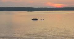 Stock Video Footage of Two canoes and a boat on beautiful sunset at Killbear Provincial Park