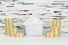 House between step pile of gold coins on finance account Stock Photos
