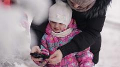 little girl mother dress gloves winter park - stock footage