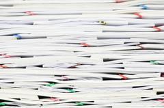 Close up pile document with colorful paperclip Stock Photos