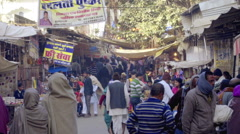 Crowd of people on local street in India - stock footage