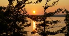 Beautiful twilight on lake seen through trees at  Killbear Provincial Park Stock Footage