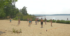 Stock Video Footage of People playing beach volley near the lake at Killbear Provincial Park