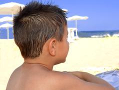 Kid contemplate the sea Stock Photos