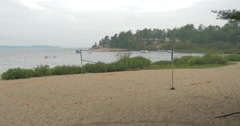 Stock Video Footage of Beach volleyball ground and people swimming at Killbear Provincial Park