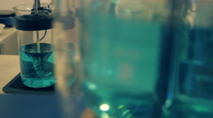Magnetic stirrer and classic stirrer of liquid is prepared solution - stock footage