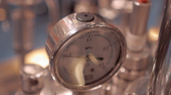 Gauge monitors the pressure in the piping system Stock Footage