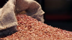 Red rice in gunny sack isolated on black, rotating Stock Footage