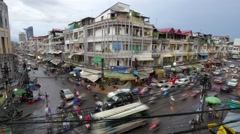 Stock Video Footage of TIMELAPSE Chaotic intersection day to night,Phnom Penh,Cambodia