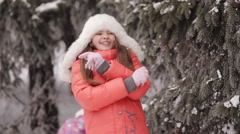 Little girl laughing and throwing snow Stock Footage