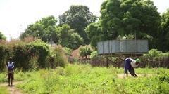 Water deposit africa village Stock Footage