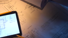 Desktop engineer. Tablet PC with the drawings. Stock Footage