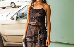Young intelligent university student holding a notepad , stylish teenager girl Stock Photos