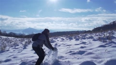 hikers spread fluffy snow in slow motion - stock footage