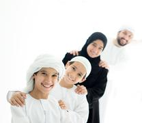 Happy Arabic family having fun time standing in line at home Stock Photos