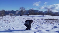 man sprayed powder snow in slow motion in mountain - stock footage