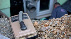 Vacuum cleaner on top of dug hole close-up Stock Footage