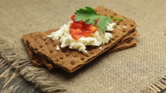 Crispbread with soft cottage cheese and red pepper - stock footage