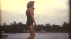 1952, Woman in bathing suit walk on dock Stock Footage