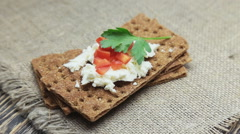 Crispbread with soft cottage cheese and red pepper Stock Footage